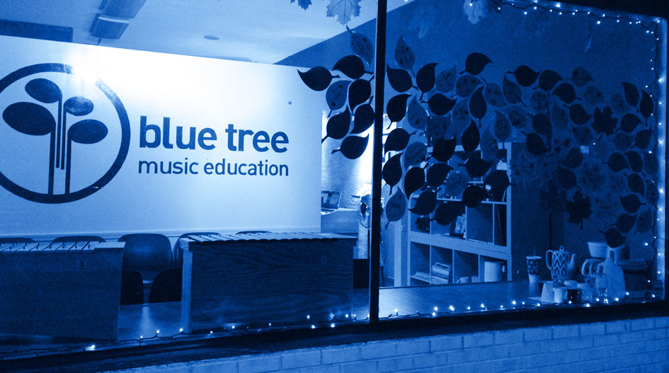 blue-tree-music-education-hero-store-window-sign